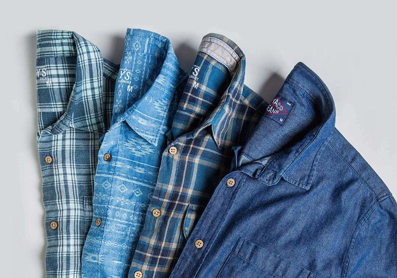 camisas dobradas em leque estampadas lisas e jeans